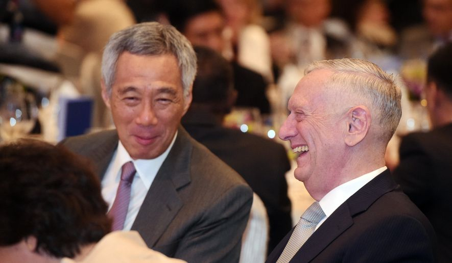 U.S. Defense Secretary Jim Mattis, right, sits with Singapore's Prime Minister Lee Hsien Loong as they attend the opening dinner of the 16th International Institute for Strategic Studies Shangri-la Dialogue, or IISS, Asia Security Summit on Friday, June 2, 2017 in Singapore. (AP Photo/Joseph Nair)