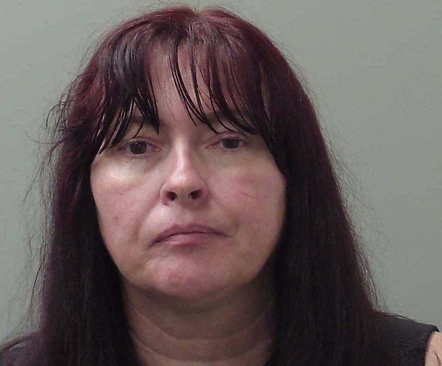 Susanna Burhans, shown here in a mugshot from the Madison County, Alabama, Sheriff's Office, via AL.com (AL.com). Ms. Burhans is charged with an animal cruelty felony for allegedly feeding a dog meatballs laced with nails. A postal carrier, Ms. Burhans was walking her delivery route at the time, according to investigators.