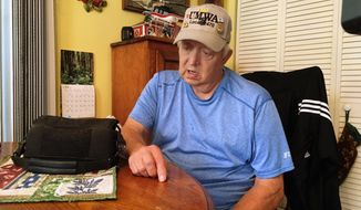 Retired coal miner Kenny Smith sits at his kitchen table in Centertown, Ky., Thursday, June 1, 2017, as he speaks during an interview. President Donald Trump announce Thursday during a news conference a decision to pull out of the landmark Paris climate accord. Smith worked in underground mines in western Kentucky until he retired in the 1990s after 22 years. He supports Trumps decision to pull out of the accord. Next to Smith on the table is the heart pump that keeps him alive. (AP Photo/Dylan Lovan)