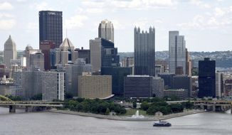 """In this May 31, 2017, photo a Gateway Clipper ship approaches the Point as it passes in front of the Pittsburgh downtown skyline. President Donald Trump framed his decision to leave the Paris climate accord during a news conference on Thursday, June 1 as """"a reassertion of America's sovereignty,"""" he said, """"I was elected to represent the citizens of Pittsburgh, not Paris."""" (Darrell Sapp/Pittsburgh Post-Gazette via AP)"""