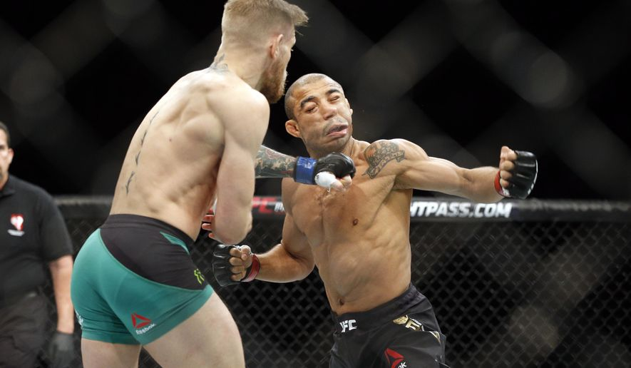 FILE - In this Dec. 12, 2015 file photo, Conor McGregor knocks out Jose Aldo during a featherweight championship mixed martial arts bout at UFC 194, in Las Vegas. Aldo wants to re-establish his dominance in the UFC featherweight division 18 months after his stunning loss to McGregor. Top contender Max Holloway will attempt to interrupt Aldo's revival at UFC 212 in Rio de Janeiro on Saturday, June 3, 2017.  (AP Photo/John Locher, File)