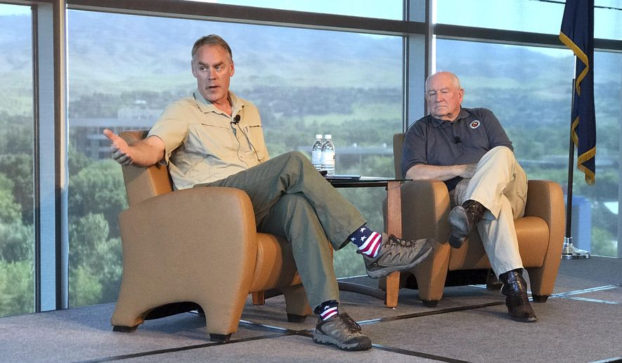 U.S. Interior Secretary Ryan Zinke, left, and Agriculture Secretary Sonny Perdue speak in Boise, Idaho, on Friday, June 2, 2017. Both emphasized cooperation among federal, state, tribal and local agencies in battling wildfires as the main part of the wildfire season arrives. (AP Photo/Keith Ridler)