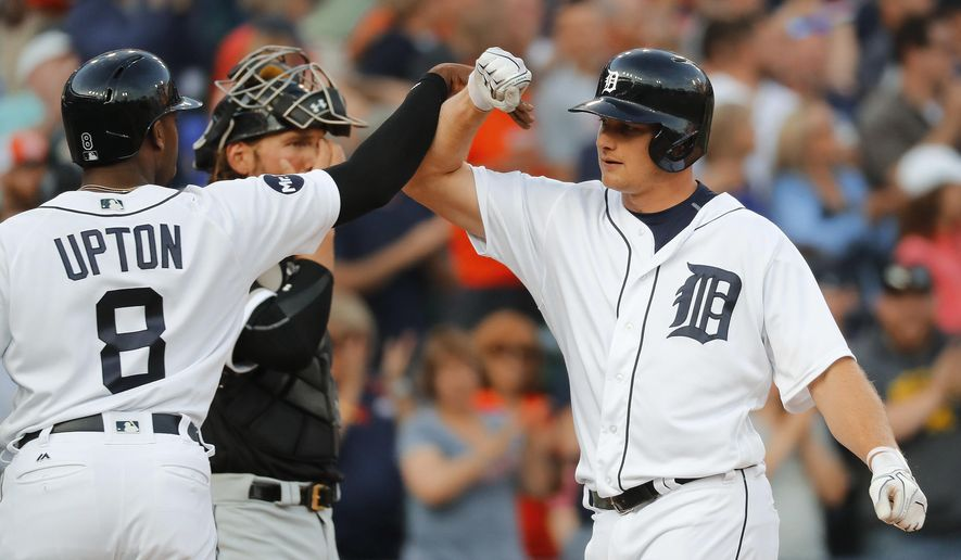 Detroit Tigers' John Hicks, right, celebrates his two-run home run against the Chicago White Sox with Justin Upton (8) in the third inning of a baseball game in Detroit, Friday, June 2, 2017. (AP Photo/Paul Sancya)