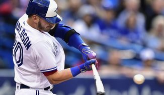 Toronto Blue Jays' Josh Donaldson hits a solo home run against the New York Yankees during the first inning of a baseball game Friday, June 2, 2017, in Toronto. (Frank Gunn/The Canadian Press via AP)