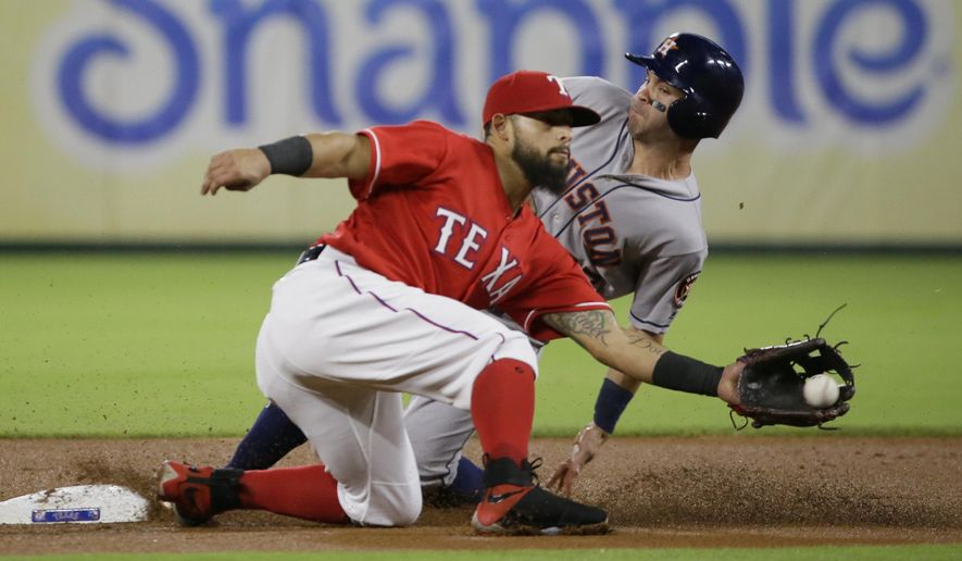 Houston Astros Jose Altuve, right, steals second base against Texas Rangers second baseman Rougned Odor (12) during the first inning of a baseball game  in Arlington, Texas, Friday, June 2, 2017. (AP Photo/LM Otero)