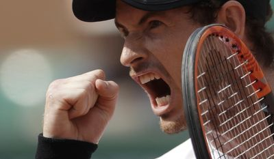 Britain's Andy Murray clenches his fist after a winning point as he plays Slovakia's Martin Klizan during their second round match of the French Open tennis tournament at the Roland Garros stadium, Thursday, June 1, 2017 in Paris. Murray won 6-7, 6-2, 6-2, 7-6. (AP Photo/Petr David Josek)