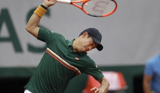 Japan's Kei Nishikori breaks his racket in his third round match of the French Open tennis tournament against Korea's Hyeon Chung at the Roland Garros stadium, in Paris, France. Saturday, June 3, 2017. (AP Photo/Petr David Josek)