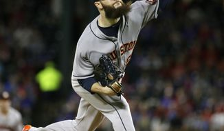 Houston Astros starting pitcher Dallas Keuchel throws during the first inning of a baseball game against the Texas Rangers in Arlington, Texas, Friday, June 2, 2017. (AP Photo/LM Otero)