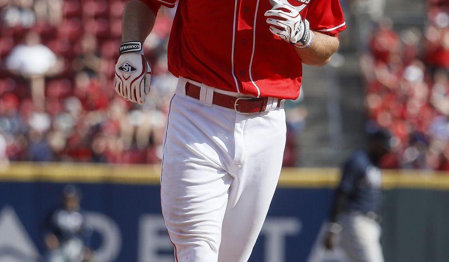 Cincinnati Reds' Jose Peraza runs the bases after hitting a solo home run off Atlanta Braves starting pitcher R.A. Dickey in the fourth inning of a baseball game, Saturday, June 3, 2017, in Cincinnati. (AP Photo/John Minchillo)