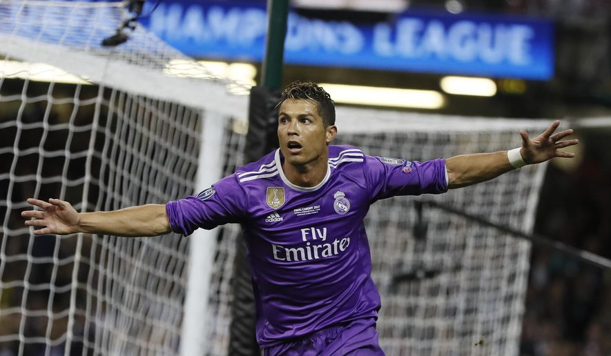 Real Madrid's Cristiano Ronaldo celebrates after scoring during the Champions League final soccer match between Juventus and Real Madrid at the Millennium Stadium in Cardiff, Wales, Saturday June 3, 2017. (AP Photo/Kirsty Wigglesworth)