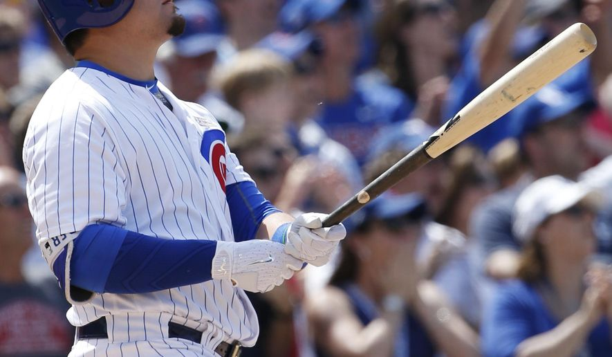 Chicago Cubs' Kyle Schwarber watches after hitting a grand slam during the seventh inning of a baseball game against the St. Louis Cardinals Saturday, June 3, 2017, in Chicago. (AP Photo/Nam Y. Huh)