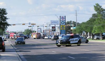 Local and state law enforcement and Fire Department personnel respond to the scene of a shootout between a homicide suspect and Laredo police officers outside a Valero gas station Friday, June 2, 2017, in Laredo, Texas. (Cuate Santos/The Laredo Morning Times via AP)