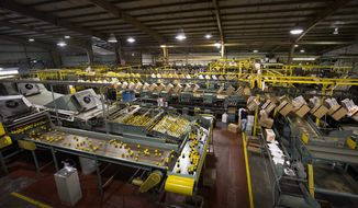 FOR RELEASE SATURDAY, JUNE 3, 2017, AT 3 A.M. EDT. - In this photo taken May 19, 2017, the packing line runs at Peace River Citrus packinghouse in Fort Meade, Fla. (Ernst Peters/The Ledger via AP)