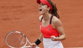France's Alize Cornet reacts after winning a point as she plays Poland's Agnieszka Radwanska during their third round match of the French Open tennis tournament at the Roland Garros stadium, Saturday, June 3, 2017 in Paris. (AP Photo/Christophe Ena)