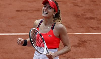 France's Alize Cornet clenches her fist after defeating Poland's Agnieszka Radwanska in their third round match of the French Open tennis tournament at the Roland Garros stadium, Saturday, June 3, 2017 in Paris. Cornet won 6-2, 6-1. (AP Photo/Christophe Ena)