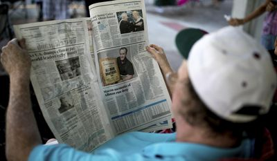 Dwayne Lewis reads a local newspaper covering the death of Gregg Allman, Saturday, June 3, 2017, in Macon, Ga.  Legions of fans are expected to line the streets of Macon, Georgia, as the music legend is carried to his final resting place in the same cemetery where he and his band members used to hang out and write songs amid the tombstones. (AP Photo/Branden Camp)