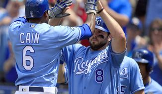 Kansas City Royals center fielder Lorenzo Cain (6) is congratulated by Kansas City Royals third baseman Mike Moustakas (8) following his two-run home run in the fifth inning of a baseball game against the Cleveland Indians at Kauffman Stadium in Kansas City, Mo., Saturday, June 3, 2017. (AP Photo/Orlin Wagner)