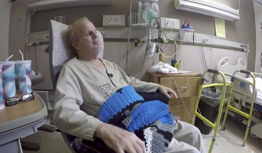 In this January 2017 photo, Vietnam Navy veteran Brian Mildenhall, a patient at the Veterans Medical Center in Salt Lake City, talks about how much the handmade blanket crocheted by inmates at Utah State Prison means to him. (John Wilson/KSL-TV/The Deseret News via AP)