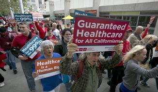 In this April 26, 2017 file photo supporters of single-payer health care march to the Capitol in Sacramento, Calif. A poll released on April 13, 2018, finds that a slim majority of Americans now support the idea of a government-run single-payer health care system. (AP Photo/Rich Pedroncelli file) **FILE**