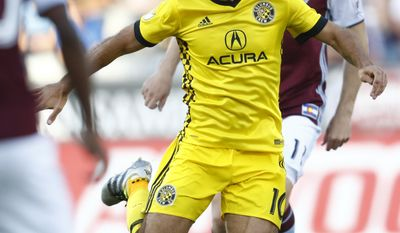 Columbus Crew forward Federico Higuain, front, kicks the ball as Colorado Rapids midfielder Shkelzen Gashi pursues in the first half of an MLS soccer game Saturday, June 3, 2017, in Commerce City, Colo. (AP Photo/David Zalubowski)
