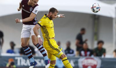 Colorado Rapids forward Kevin Doyle, left, collides with Columbus Crew defender Josh Williams during the first half of an MLS soccer match Saturday, June 3, 2017, in Commerce City, Colo. (AP Photo/David Zalubowski)