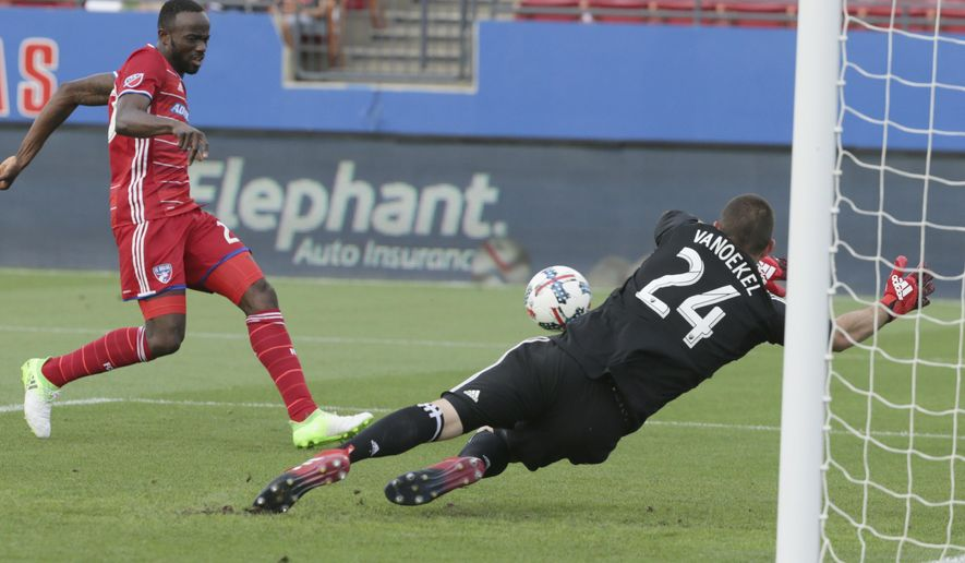 FC Dallas forward Roland Lamah, left, scores a goal against Real Salt Lake goalkeeper Matt Van Oekel (24) during the first half of an MLS soccer match in Frisco, Texas, Saturday, June 3, 2017. (AP Photo/LM Otero)