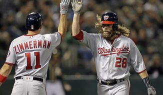 Washington Nationals' Jayson Werth, right, is congratulated by Ryan Zimmerman after hitting a home run against the Oakland Athletics during the sixth inning of a baseball game Friday, June 2, 2017, in Oakland, Calif. (AP Photo/Ben Margot)