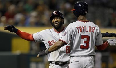 Washington Nationals' Brian Goodwin, left, is congratulated by Michael Taylor (3) after hitting a two-run home run off Oakland Athletics' Zach Neal iduring the seventh inning of a baseball game Friday, June 2, 2017, in Oakland, Calif. (AP Photo/Ben Margot)