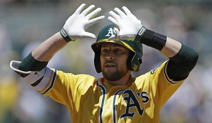 Oakland Athletics' Jed Lowrie celebrates after hitting a two run home run off Washington Nationals' Joe Ross in the first inning of a baseball game Saturday, June 3, 2017, in Oakland, Calif. (AP Photo/Ben Margot)