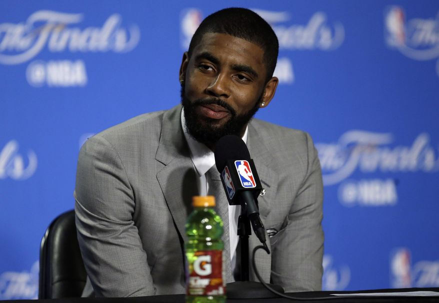 Cleveland Cavaliers guard Kyrie Irving answers questions after Game 1 of basketball's NBA Finals against the Golden State Warriors Thursday, June 1, 2017, in Oakland, Calif. (AP Photo/Ben Margot)