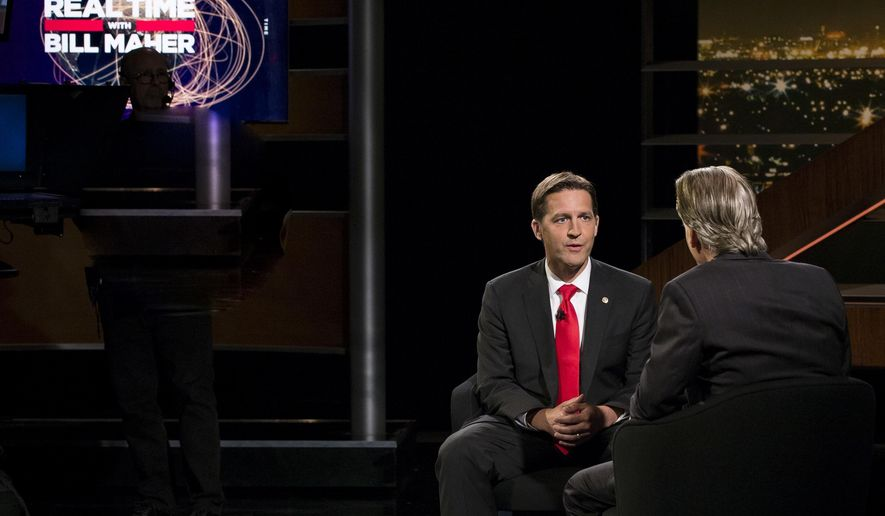 "In this photo provided by HBO, Bill Maher, left, speaks with Sen. Ben Sasse, R-Neb, during a segment of his ""Real Time with Bill Maher,"" Friday, June 2, 2017. Maher is facing criticism for his use of a racial slur during a discussion with the Republican senator on his HBO talk show Friday night. (Janet Van Ham/HBO via AP)"