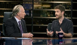 "In this photo provided by HBO, Bill Maher, left, speaks with Sen. Ben Sasse of Nebraska during a segment of his ""Real Time with Bill Maher,"" Friday, June 2, 2017. Maher is facing criticism for his use of a racial slur during a discussion with the Republican senator on his HBO talk show Friday night. (Janet Van Ham/HBO via AP)"