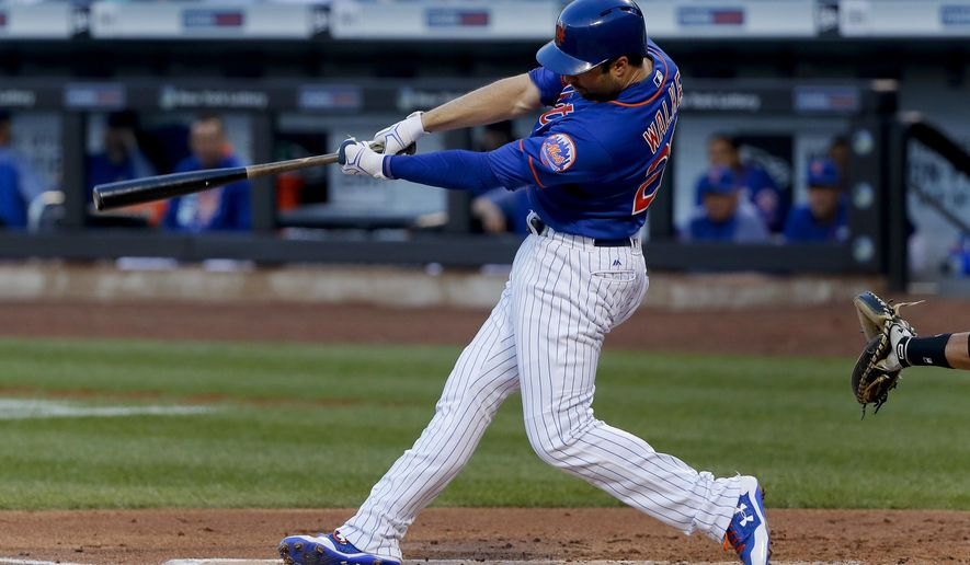 New York Mets' Neil Walker (20) swings on a two-run home run against the Pittsburgh Pirates during the first inning of a baseball game, Saturday, June 3, 2017, in New York. (AP Photo/Julie Jacobson)