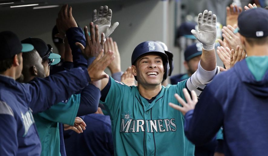 Seattle Mariners' Danny Valencia is congratulated by teammates on his three-run home run against the Tampa Bay Rays during the third inning of a baseball game Friday, June 2, 2017, in Seattle. (AP Photo/Elaine Thompson)