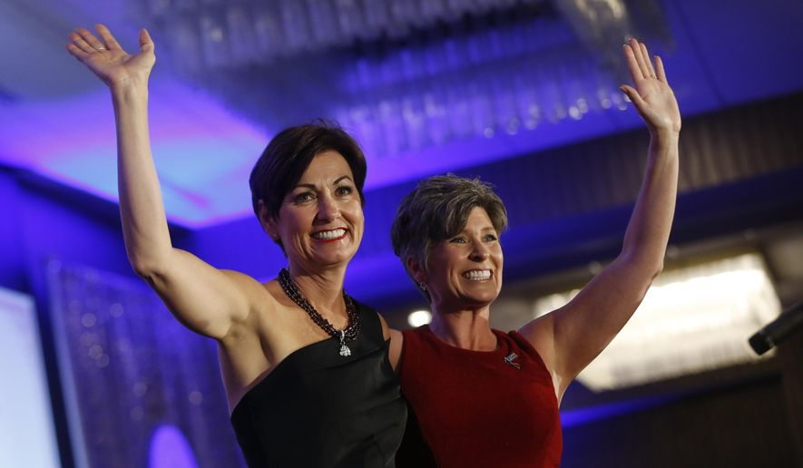 Gov. Kim Reynolds, left, and Sen. Joni Ernst wave to the crowd as Reynolds takes the stage during the governor's Inaugural Celebration hosted by the Republican Party of Iowa, Friday, June 2, 2017, in Des Moines, Iowa. The unofficial inaugural event raises money for the Republican Party, a strategic move that highlights the GOP's focus on the upcoming midterm election and Reynolds' anticipated gubernatorial run. (Michael Zamora/The Des Moines Register via AP  )