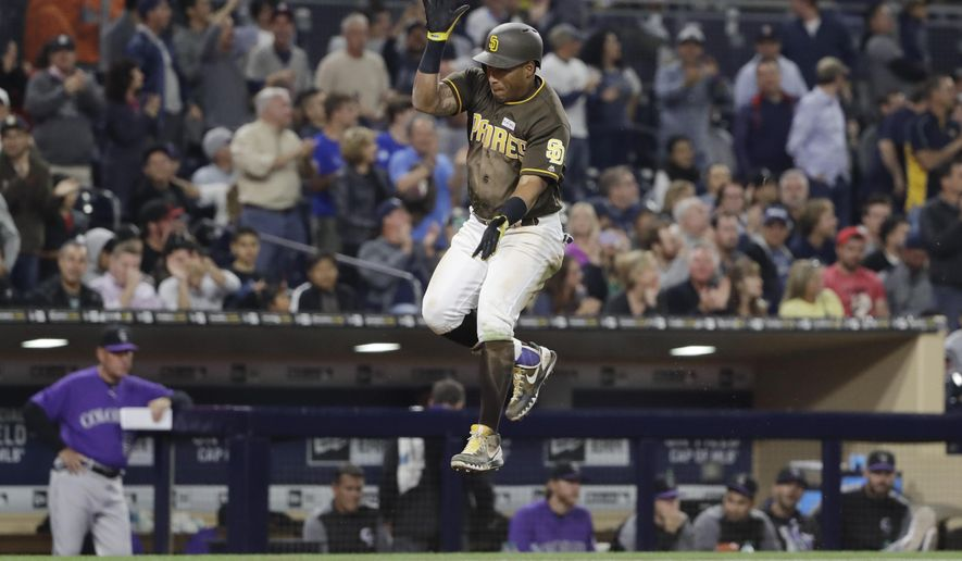San Diego Padres' Yangervis Solarte jumps on the way to home after hitting a two-run home run during the fifth inning of the team's baseball game against the Colorado Rockies on Friday, June 2, 2017, in San Diego. (AP Photo/Gregory Bull)