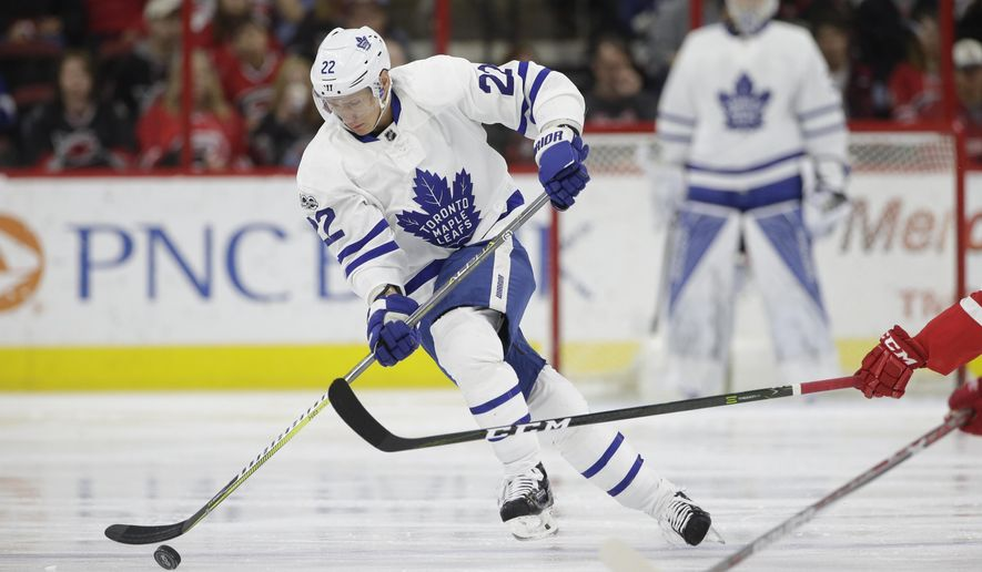 FILE - In this March 11, 2017, file photo, Toronto Maple Leafs' Nikita Zaitsev (22), of Russia, skates against the Carolina Hurricanes during the first period of an NHL hockey game in Raleigh, N.C.  Zaitsev shows that Russia has become a reliable pipeline for ready-made NHL talent. (AP Photo/Gerry Broome, File)