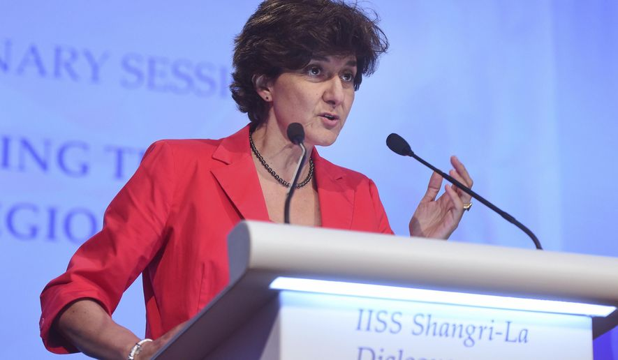 "France's Armed Services Minister Sylvie Goulard gives a speech about ""Upholding the Rules-Based Regional Order"" at the 2017 International Institute for Strategic Studies (IISS) Shangri-la Dialogue, an annual defense and security forum in Asia, Saturday, June 3, 2017 in Singapore. (AP Photo/Joseph Nair)"