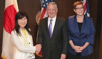 "U.S. Defense Secretary Jim Mattis, center, shakes hands with Japan's Defense Minister Tomomi Inada, left, as Australian Defense Minister Marise Payne smiles while posing for a photograph before a trilateral meeting at the International Institute for Strategic Studies (IISS) Shangri-la Dialogue, an annual defense and security forum in Asia, on Saturday, June 3, 2017 in Singapore. North Korea is accelerating its push to acquire a nuclear-armed missile capable of threatening the United States and other nations, and the U.S. regards this as a ""clear and present danger,"" Mattis said in his speech at the forum. (AP Photo/Joseph Nair)"
