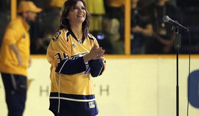 Country music performer Martina McBride acknowledges the crowd after singing the national before Game 3 of the NHL hockey Stanley Cup Finals Saturday, June 3, 2017, in Nashville, Tenn. (AP Photo/Mark Humphrey)