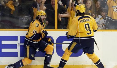 Nashville Predators right wing Craig Smith (15) celebrates his goal against the Pittsburgh Penguins with Filip Forsberg (9), of Sweden, during the third period in Game 3 of the NHL hockey Stanley Cup Finals Saturday, June 3, 2017, in Nashville, Tenn. (AP Photo/Mark Humphrey)