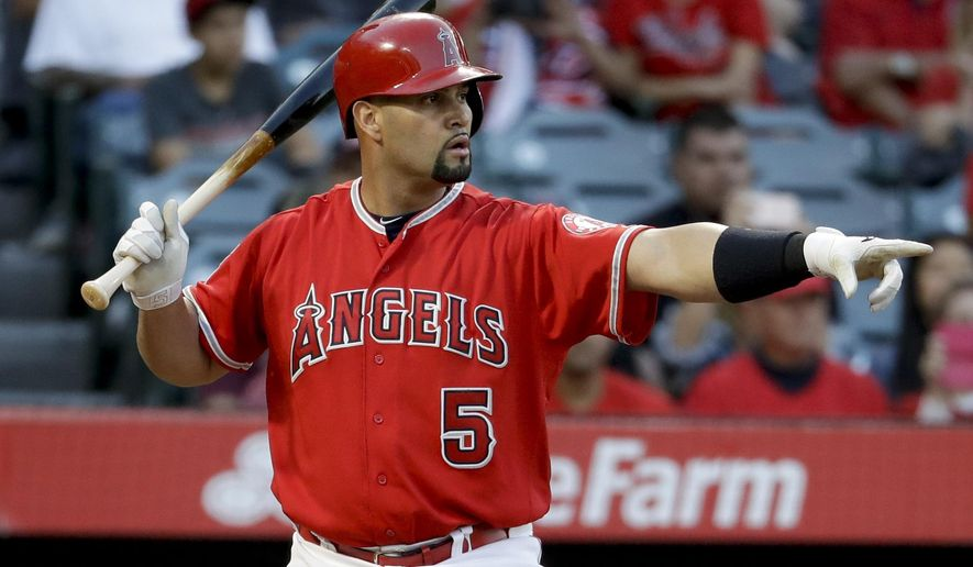 Los Angeles Angels' Albert Pujols points after a balk by Minnesota Twins starting pitcher Adalberto Mejia during the first inning of a baseball game in Anaheim, Calif., Thursday, June 1, 2017. (AP Photo/Chris Carlson)