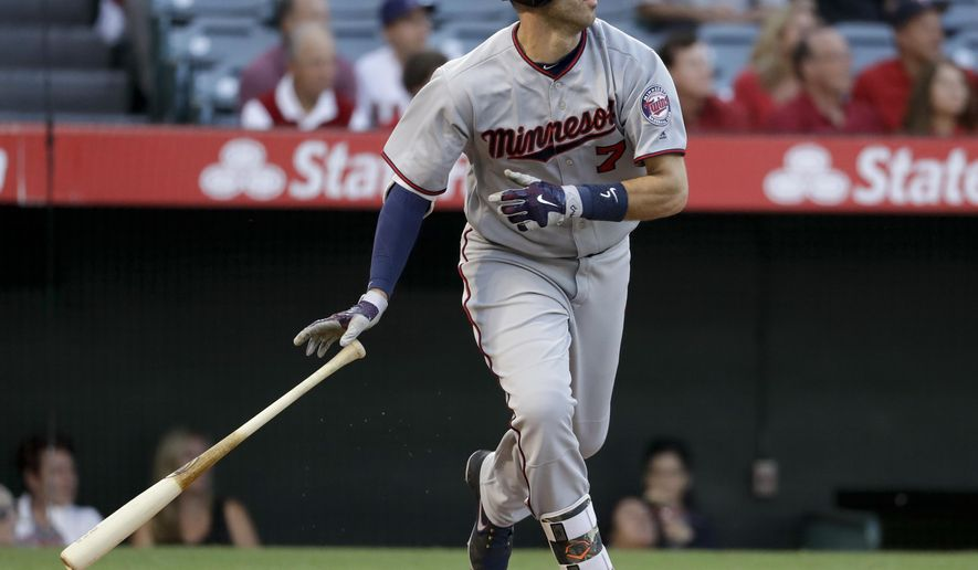 Minnesota Twins' Joe Mauer watches his two-run home run during the first inning of the team's baseball game against the Los Angeles Angels in Anaheim, Calif., Friday, June 2, 2017. (AP Photo/Chris Carlson)