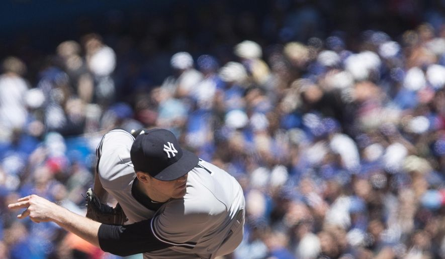 New York Yankees starting pitcher Jordan Montgomery works against the Toronto Blue Jays during first inning baseball action in Toronto on Saturday, June 3, 2017. (Chris Young/The Canadian Press via AP)