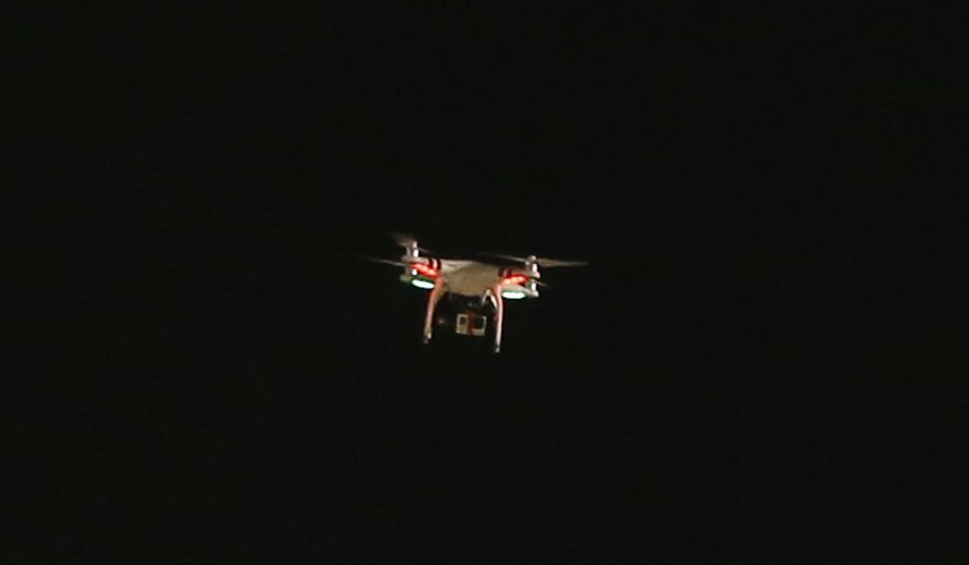 A drone with a camera hanging from it flies over PNC Park during the baseball game between the Pittsburgh Pirates and the New York Mets on Thursday, June 26, 2014, in Pittsburgh. (AP Photo/Keith Srakocic)
