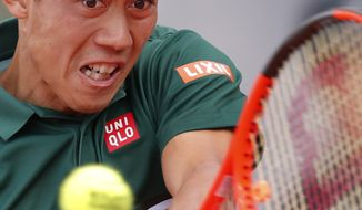 Japan's Kei Nishikori plays a shot against Korea's Hyeon Chung during their third round match of the French Open tennis tournament at the Roland Garros stadium, in Paris, France. Sunday, June 4, 2017. (AP Photo/Christophe Ena)