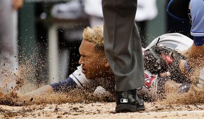 Cleveland Indians' Jose Ramirez is tagged out at home by Kansas City Royals catcher Drew Butera as he tried to score on a double by Austin Jackson during the fourth inning of a baseball game Sunday, June 4, 2017, in Kansas City, Mo. (AP Photo/Charlie Riedel)
