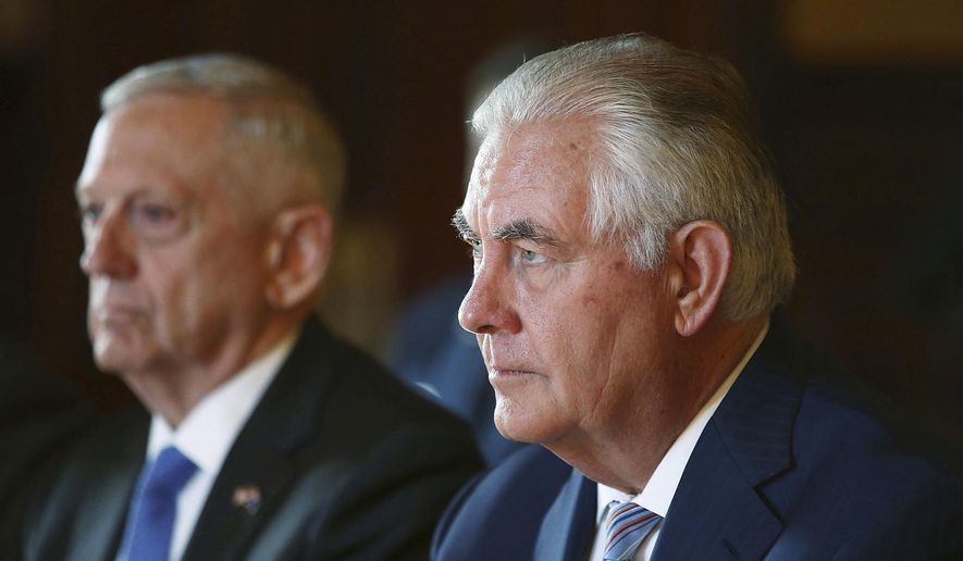 U.S. Secretary of State Rex Tillerson, right, and U.S. Secretary of Defence Jim Mattis participate in talks at Government House in Sydney for the 2017 Australia-United States Ministerial Consultations (AUSMIN) Monday, June 5, 2017 in this file photo. Mr. Tillerson on June 9 called on an easing of the blockade of Qatar by member states of the Gulf Cooperation Council. (Mark Metcalfe/Pool Photo via AP)
