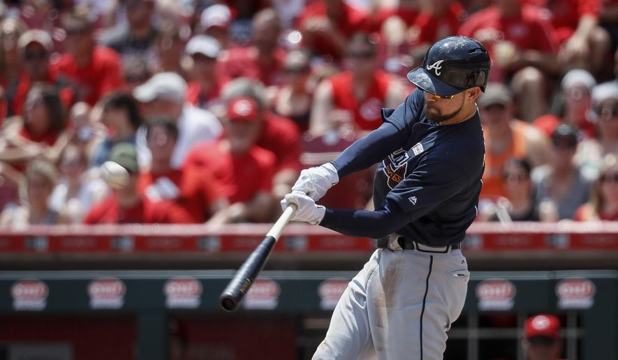 Atlanta Braves' Ender Inciarte hits a three-run home run off Cincinnati Reds starting pitcher Amir Garrett in the third inning of a baseball game, Sunday, June 4, 2017, in Cincinnati. (AP Photo/John Minchillo)