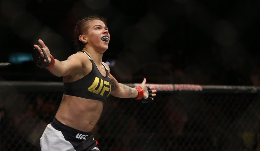 Claudia Gadelha, of Brazil, celebrates after defeating Karolina Kowalkiewicz, of Poland, during their UFC strawweight mixed martial arts bout in Rio de Janeiro, Brazil, early Sunday, June 4, 2017. (AP Photo/Leo Correa)